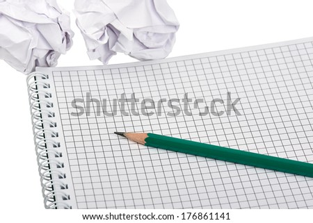 A notebook with pencil and several crumpled paper isolated on a white background  - stock photo