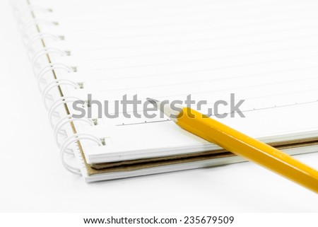 a notebooks and pencil on white background