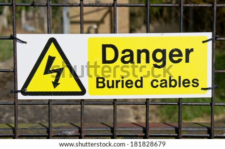 A notice warning of buried electric cables