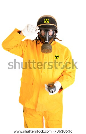 """A Nuclear Safety Inspector wears his """"Anti-Radiation"""" suit, gas mask, police helmet and holds his Geiger Counter while isolated on white with room for your text - stock photo"""