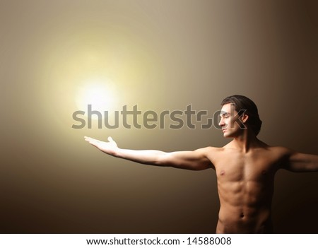 a nude man with a light on the hand