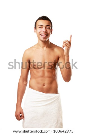 A nude young man covering himself with a towel, isolated on white background - stock photo