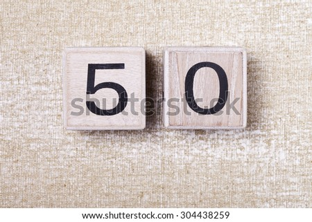 a number  fifty  50 wooden cubes - stock photo