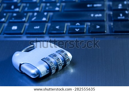 A number lock padlock on a laptop to illustrate data security - stock photo