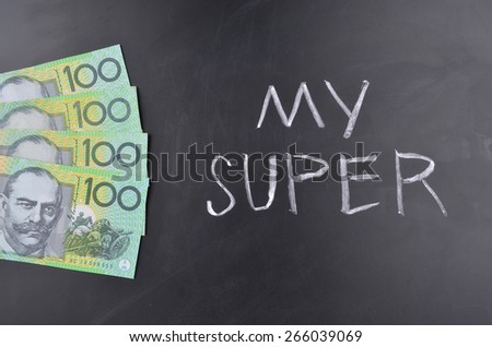 A number of Australian one hundred dollar notes stuck on a blackboard where My Super is handwritten in white chalk. - stock photo