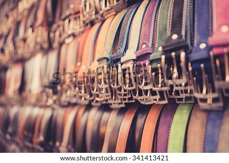 A number of belts in a Florence market. - stock photo
