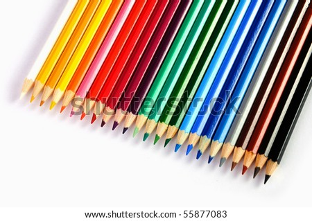 A number of colored pencils on a white background