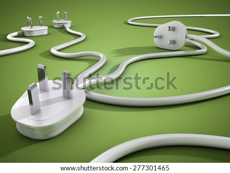 A number of Electricity cables and plugs lay on the floor. Concept for power and electricity usage. - stock photo