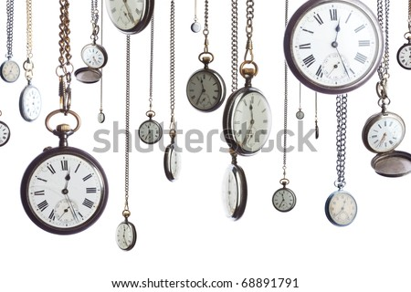 A number of pocket watches on chain isolated on white - stock photo