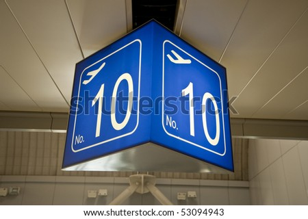 A number ten gate sign in an airport