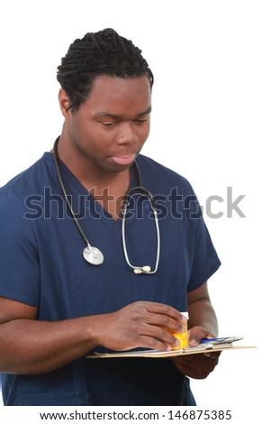 A nurse check dosage on medicine - stock photo