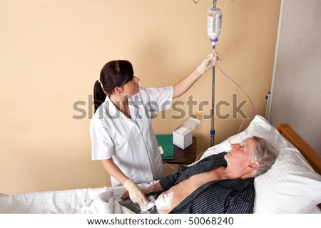 A nurse gave a patient an infusion - stock photo