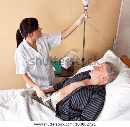 a nurse gives a patient an infusion - stock photo