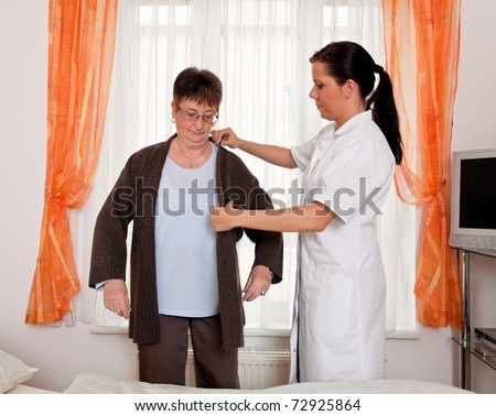 a nurse in aged care for the elderly in nursing homes - stock photo