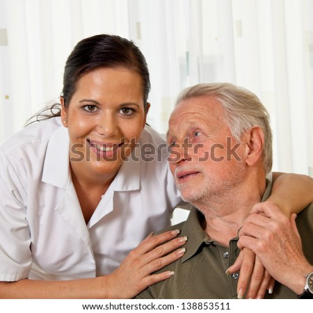 a nurse in elderly care for seniors in nursing homes - stock photo