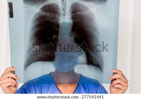 a nurse or doctor in surgical clothing before surgery. symbolic photo for work in the hospital - stock photo