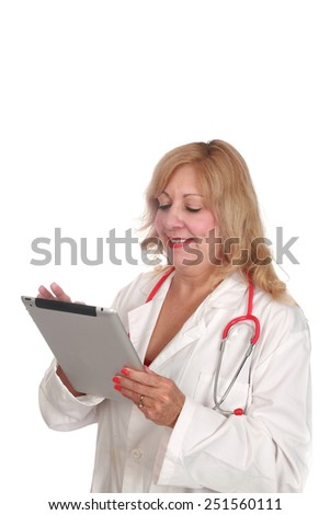 A nurse or doctor uses a computer tablet to take notes, write prescriptions, check patients charts, write and read emails, play solitaire, and chat with friends on line around the world. on white - stock photo