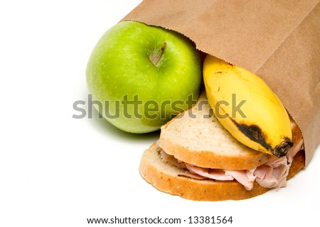 A nutritious lunch in a brown bag. - stock photo