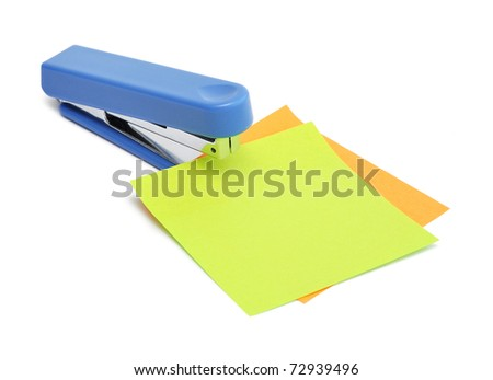 A office stapler with blank note paper on a white background - stock photo
