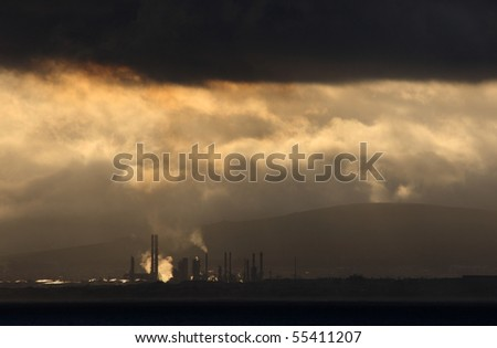 A oil refinery under clouds.