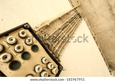 A old electricity installation with cables. - stock photo