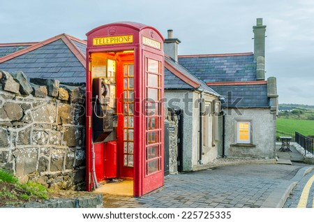 A old English telephone booth next to a pub at the Giant's Causeway, Northern Ireland - stock photo