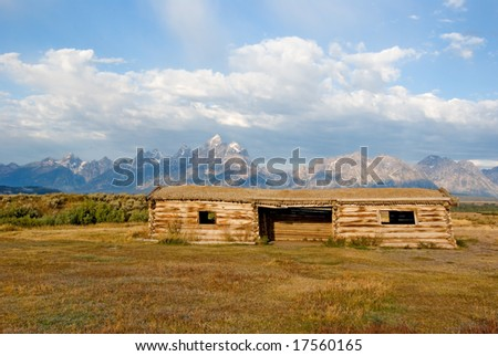 A old fram house in front of the Grand Tetons