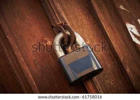 a old locked door - stock photo