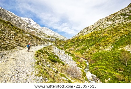 A old man walking near of the Espiguete peak in the mountains of Palencia, Castilla-Leon, Spain - stock photo