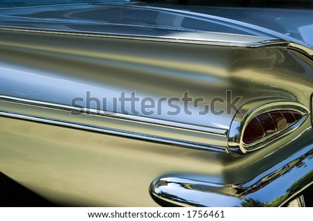 A old model silver car. - stock photo
