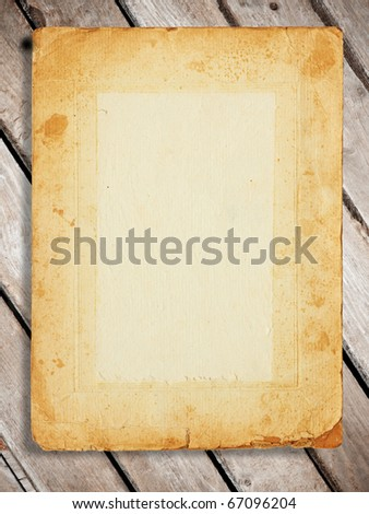 a old paper on wooden desks as a background or texture - stock photo