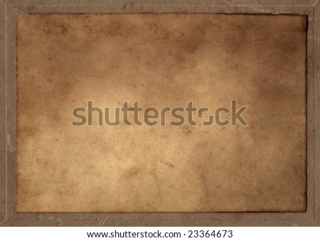 A old parchment rectangle pasted on a cardboard. - stock photo