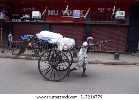 A old rickshaw puller takes merchandise as shop closed due to Nation wide General strike called by leftist Trade Unions on September 02, 2015 in Calcutta, India.