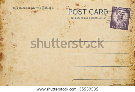 A old vintage blank postcard with a canceled three cent Lady Liberty stamp. - stock photo
