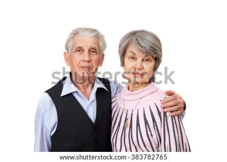 A older couple, isolated on white background - stock photo