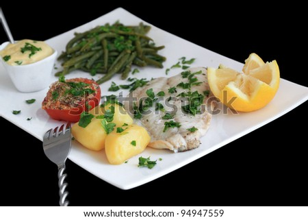 """Aïoli (Northern Mediterranean dish with poached fish & vegetables served with a garlic mayonnaise made with olive oil. """"Aïoli"""" is a Provencal word meaning garlic (ail) and oil (oli). - stock photo"""