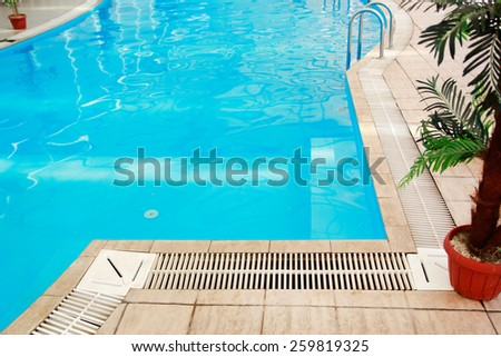 a one blue water swimming pool  - stock photo