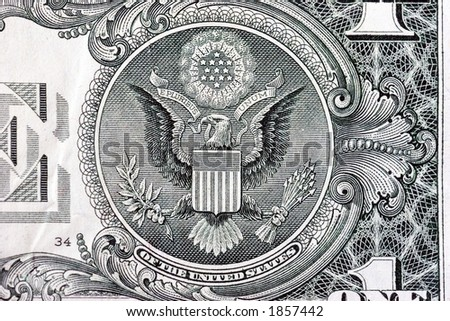 A one dollar bill close up, showing the eagle on the great seal of the United States. - stock photo