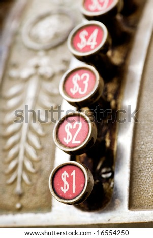 A one dollar button on a vintage cash register - stock photo