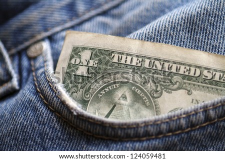 A one  dollar note in the pocket of denim trousers. - stock photo