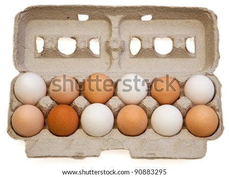 A one dozen carton of free range organic eggs from various chickens in different colors and sizes isolated on a white background. - stock photo
