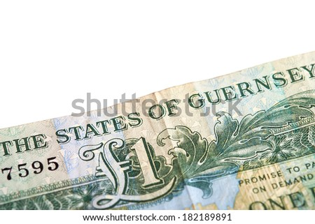 A one pound note from the Island of Guernsey on a white background. - stock photo