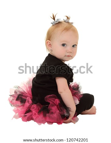 A one year old girl in a tutu with pigtails takes a break from dancing isolated on white - stock photo
