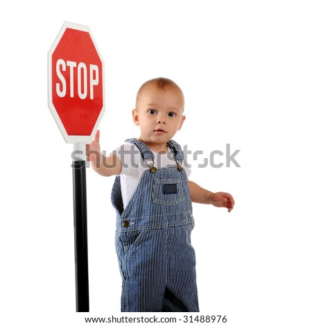 A one-year old looking at the viewer while displaying a stop sign.  Isolated on white. - stock photo