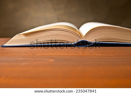 a open book on the brown table - stock photo