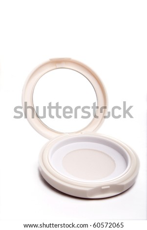 A opened cosmetic mirror on white background - stock photo