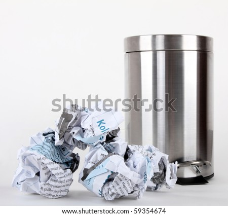a opened pedal bin and rubbish isolated on white background - stock photo