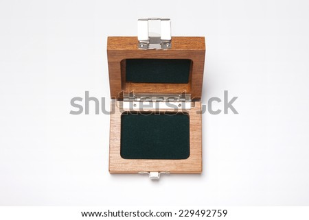 A opened wooden box for accessory isolated white, top view at the studio.