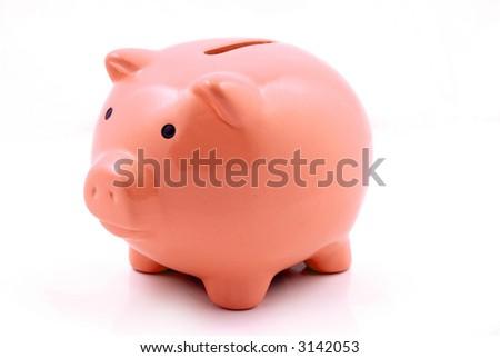 A Orange piggy bank for coin deposits - stock photo
