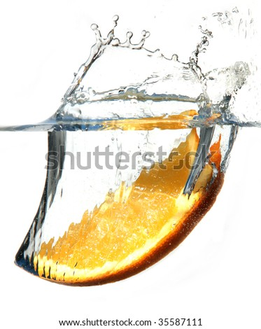 A orange splashing into water against a white background. Hi-speed shoot. EOS 1Ds mkII. - stock photo